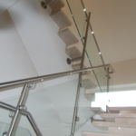 Schlosserarbeiten-Metallbauarbeiten-Treppe-Geländer-Treppenhausgeländer-LED Beleuchtung-Stahlbau-Schlosser- und Metallbauarbeiten